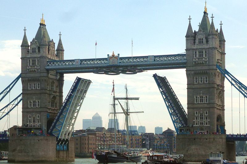 A tall ship passing under Tower Bridge decorated for the London Olympics in August 2012. Photo by Cmglee