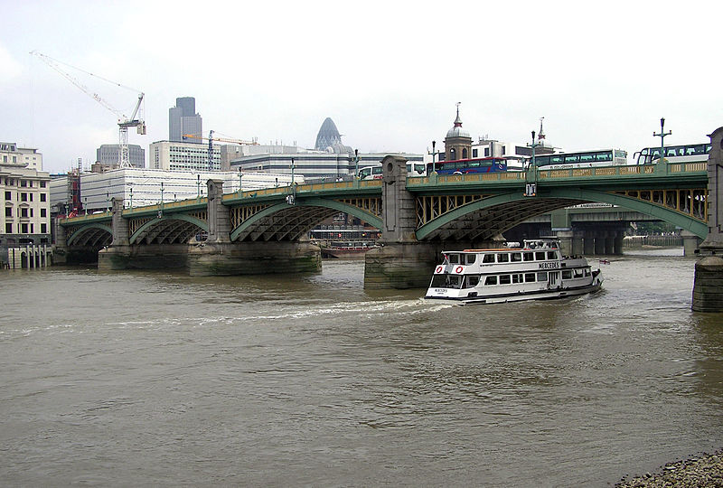 Southwark Bridge from the south bank of the Thames.  Photo: released to public domain by Arpingstone.