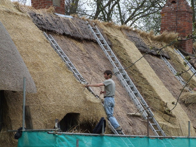 Anne Hathaway's cottage being rethatched. Photo by Michael Zawadzki from geography.org