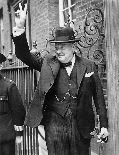 Winston Churchill emerges from 10 Downing Street flashing a V for Victory