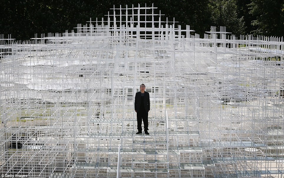 Cloud-like: Sou Fujimoto stands upon his giant creation at the Serpentine Gallery, the latest temporary installation for the gallery's pavilion