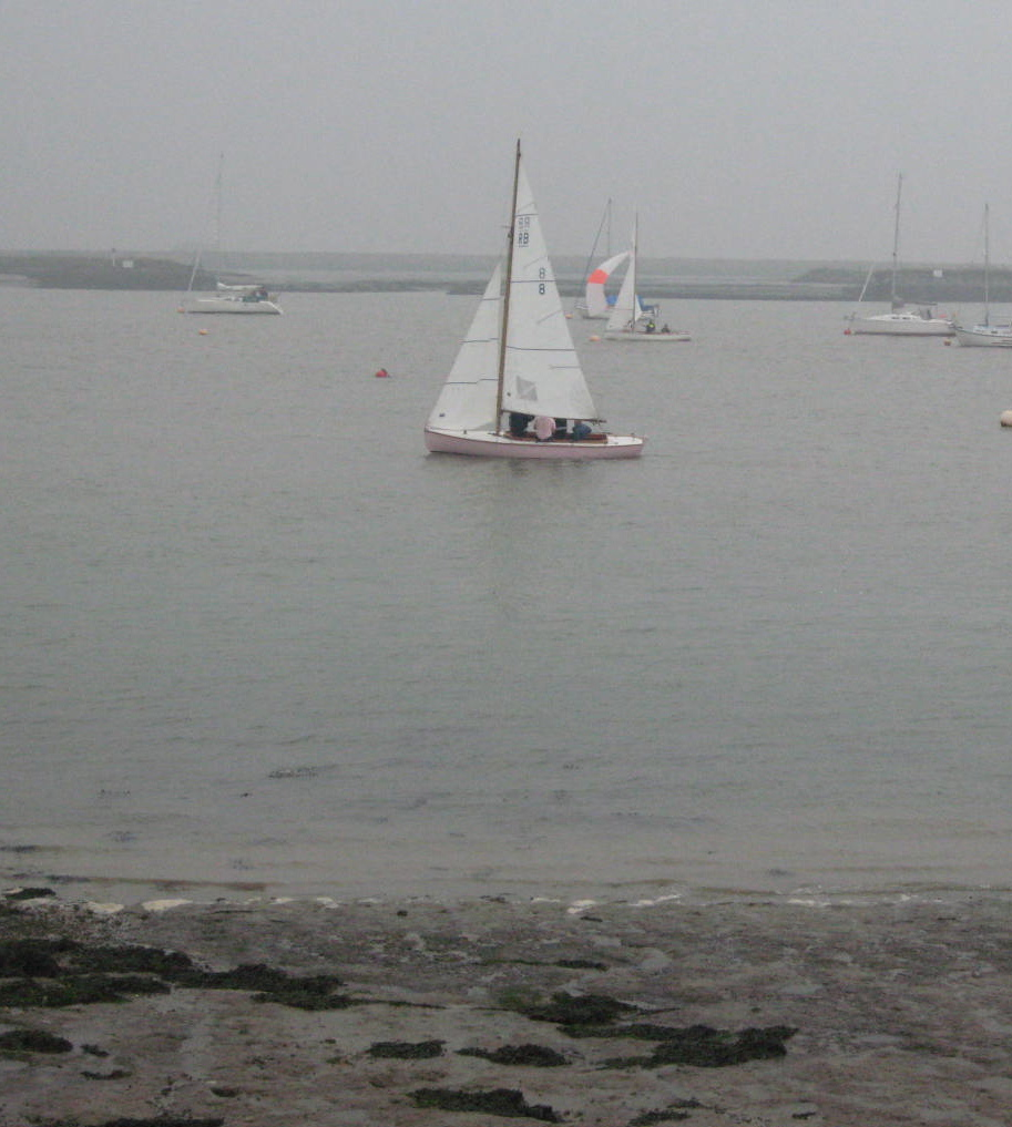 "My Beloved Brit sails out through the fog on a small boat called an ""RB"". Photo by me"